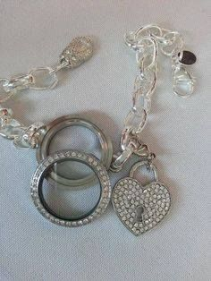 Origami Owl link locket bracelets unscrew like the lid of a jar - so you can swap our your charms & plates whenever you want!