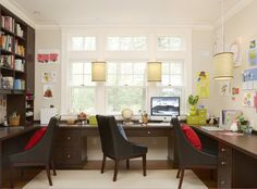 Convert formal dining room into a family office. Similar to this, but with lighter wooden furniture and different chairs.