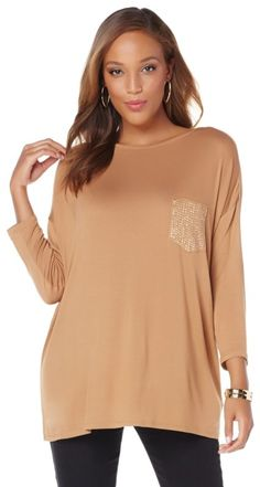 Love hanging loose? When you want to look glam and feel comfortable, throw on this oversized kimono tee for an effortlessly chic look! Wide through the body and a bit more fitted through the sleeves, this lightweight pullover wears like a poncho! The voluminous silhouette looks best over fitted pants or leggings!