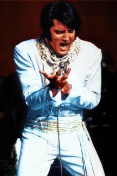 "Elvis wearing the ""The White Pearl"" jumpsuit, January 1970, Las Vegas"