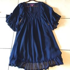 Vintage Bohemian Navy Dress Super cute on and looks cute with some cowgirl boots, heels or flats.. Navy in color, flowy and comfy, lace detailing ... Buy 3 items get 15% discount    All proceeds from sales going to help a firefighters two minor children who lost their mom in a recent tragedy.   Thank you. Have a beautiful & blessed day. Argenti Dresses