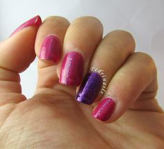 Textured nails: vertical stripes made by colorful glitter and purple accent nail