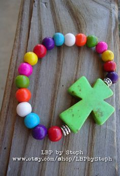 Colorful Cross and Howlite Beaded Bracelet. $12.00, via Etsy.