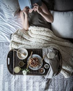 Stay cozy and chic with a chunky sweater blanket.