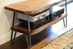 Industrial Modern Live Edge Slab TV Stand This 40+ year old tree served its original life as an Avocado tree in a California grove. It supplied America with Has