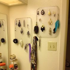 I was looking for an inexpensive way to hang my earrings and found disposable aluminum BBQ liners at Walmart a pack of 3 was around $4!!  I simply hung them up with two small nails at the top and I was done!!