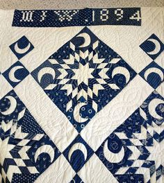 wonderful antique Indigo quilt - 1894 labelled ~ I love the crescent moons in the sashing corners too.