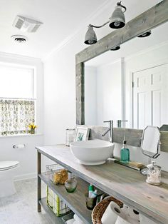 rustic graywash wood adds contrast and texture to a white bathroom