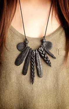 This Modern statement piece is made from polymer clay and cotton cord.  Knotted so it fits well on the body this design is very diverse and