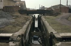 Photo taken on April 1, 1984  Bentley Canal lock 3  Opened in 1843 the Bentley Canal ran down a flight of 10 locks from the junction with the Wyrley & Essington Canal at Wednesfield for a distance of nearly three and a half miles to its junction with the Anson Branch. The section from the bottom of the six Wednesfield Locks  closed in 1960. Canal Barge, Canal Boat, Birmingham Canal, Wille, Narrowboat, Wolverhampton, Abandoned Places, Distance, England