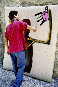 "Jean-Michel Basquiat painting ""Punch Bag"", St. Moritz, 1983. Photo Lee Jaffe."