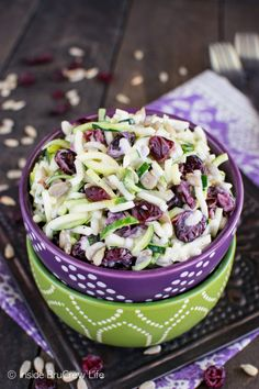 This Cranberry Zucchini Slaw is loaded with nuts and berries giving it a great sweet and salty flavor with the tangy yogurt dressing.