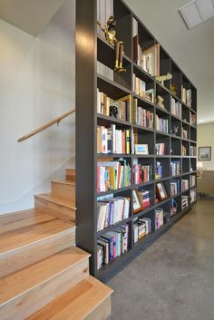 Michael Hsu designed 3 bath modern row homes in the award-winning Mueller Austin development. Bookshelf Design, Bookshelves, Staircase Bookshelf, Bookshelf Wall, Home Library Design, House Design, Austin Homes, Austin Texas, Home Libraries