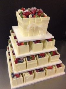 Mini cake tower with white chocolate casing and fresh berries