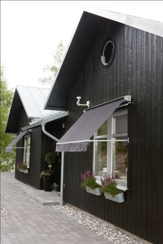 Window awnings not only decorate your house but it also protects window and provides shade.There are various types of fabrics available in the market for awning. Window Awnings, Outdoor Living, Outdoor Decor, Black House, Home Projects, Garage Doors, Shed, Outdoor Structures, Windows