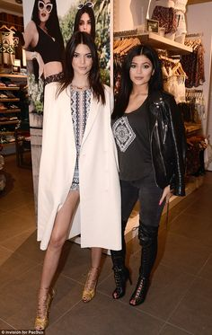 Edgy vs. elegant: Kendall, 19, and Kylie, 17, modelled outfits from their collection, contrasting like night and day in dark and light colours