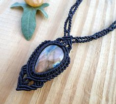 This macrame necklace features a teardrop Labradorite cabochon, set with black wax thread. The necklace is adjustable , so it can be worn long or