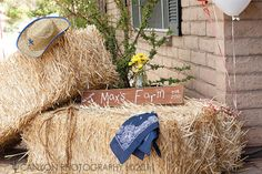 Hay bales at the entrance to a country western party-cute with a framed chalkboard for a greeting to your guests.