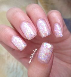 Gorgeous! Two coats of Light Elegant and some loose hexagonal iridescent glitter.