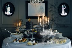An elegant Haunted Mansion dinner buffet, complete with flickering candelabra, cobwebs and duellers.  You have the internet, find a color printer -- print out Haunted Mansion photos, frame them and hang them on the walls. Instant Haunted Mansion Halloween party decor!