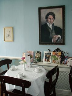 Tea Room at the Jane Austen Centre | Bath, England. note that it's colin firth on the wall, and no other mr. darcy.