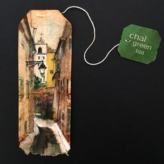 A French alley scene pained on a chai teabag.
