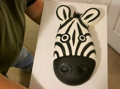 In keeping with our fondant cake-making birthday tradition, this year we decided on a zebra cake for our safari theme. We wanted more than an abstract zebra pattern, but didn't want to do a f…