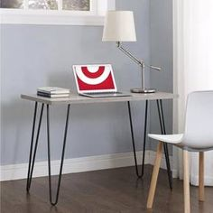 Create space in small and medium-sized rooms with the Sherbrooke Village Heywood Retro Desk. Make the most of this piece's versatility by using it as a desk, vanity or console in the office, den, living room or bedroom. Able to support up to 80 lbs., it's great for holding your laptop, important paperwork, desk lamp and family photos. Plus, the light brown/gray woodgrain finish coupled with the metal hairpin-style legs reminiscent of mid-century designs creates an ind...