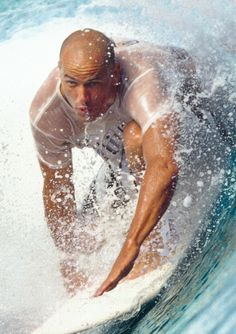 Kelly Slater is an American professional surfer. He was been crowned the ASP World Tour Champion 11 times! He is both the youngest and the oldest champion. He 'retired' to let some youngsters mature and then came out of retirement and kicked all of their collective ass.