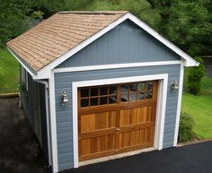 Mix and match a beautiful cedar garage door and some maintenance free siding for the perfect custom single car garage.