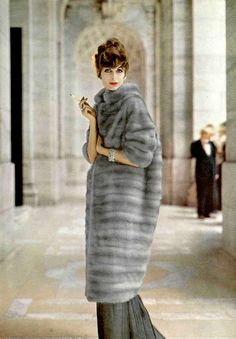 Anne St. Marie in natural blue Cerulean EMBA mink coat by Fredrica, jewelry by Cartier, photo by Virginia Thoren, 1958
