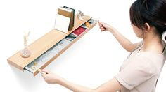 """Shelf with hidden drawer that opens with magnetic """"keys"""". Unfortunately only a prototype and not actually for sale."""