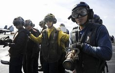 MEDITERRANEAN SEA (Oct. 21, 2013) Sailors and Marines fight a simulated fire on the flight deck of the aircraft carrier USS Nimitz (CVN 68) during a firefighting drill. Nimitz is deployed supporting maritime security operations and theater security cooperation efforts in the U.S. 6th Fleet area of responsibility. (U.S. Navy photo by Mass Communication Specialist Seaman Apprentice Kelly M. Agee/ Released