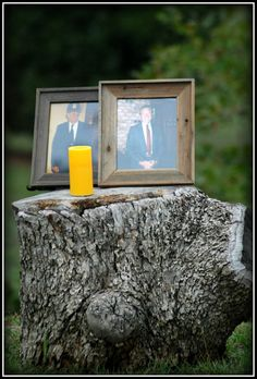 Memorial candle with our grandfathers pictures..
