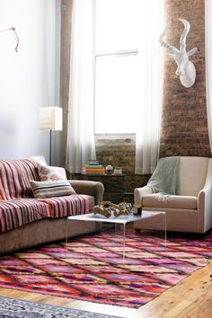 A Colorful Home in An Old Chicago Calculator Factory | Design*Sponge | Exposed Brick | Rug