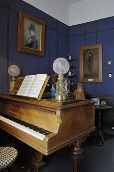 /\ /\ . Maurice Ravel . La petite maison à Montfort l'Amaury . In the office is Ravel's piano - the restored quarter-tail Erard of oak and rosewood. Above is a portrait of his mother by his uncle Jean-Edouard Ravel.