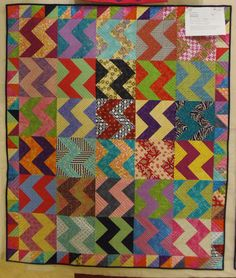 """This quilt is called """"A Nod To Maud"""". It was made from blocks won in the guild's block of the month draw. The inspiration for the block was drawn from the works of Canadian folk painter Maud Lewis."""