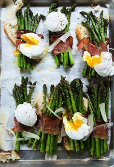 asparagus wrapped in bacon and topped with poached eggs - the perfect paleo snack