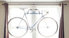 Make a Quick and Easy Bike Rack Using Old Bike Parts: If you have an old bike with drop-styled handle bars or can find the parts secondhand, you have most of what you need to make this bike rack. Wherever you want to hang your bike, screw in the handlebars (with attached stem and wall flange) and you've got a convenient holder for your bike.