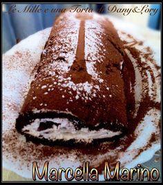 ROTOLO PANNA E CAFFÈRICETTA DI: MARCELLA MARINO  ROTOLO PANNA E CAFFÈingredienti:  3 uova grandi 100gr di zucchero 75 gr farina per dolci 50 gr cacao amaro 2 cucchiaini di lievito per dolci zucchero a velo.  Per la bagna al caffè:  70 ml di caffè espresso 20 gr di zucchero.  Per farcire e decorare:  250 panna da montare + due cucchiai di zucchero a velo Gocce di cioccolato cacao per spolverare