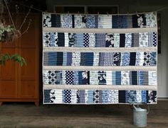"I made this stacked coins quilt for my friend Maya using blue & white to go with her living room decor. I think it looks like stacked China dishes. I quilted her favourite quote into the quilt...   ""W"