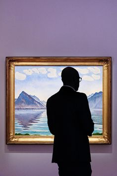 """A visitor observing Ferdinand Hodler painting """"Lake Thun, symmetric reflection"""" on display at the Rath museum in Geneva during the Hodler Parallelism temporary exhibition. Lake Thun, Ferdinand, Art Museum, Mona Lisa, Silhouette, Culture, Display, Geneva, Museums"""