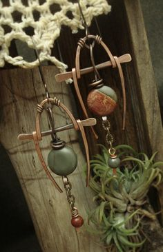 architectural, organic and just zen.....I like the shapes and materials choices for this earring set.