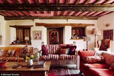 In the living room the two windows either side of the reclaimed Tudor doorway were found w...