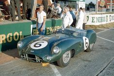 The Le Mans 24 Hours; Le Mans, June 20-21, 1959. Before the start Paul Frère, the great Belgian journalist-driver, stands next to the Aston Martin DBR1 with which he and Maurice Trintignant will finish second overall.