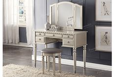 This St. Croix Collection vanity set is a fluid design of feminine accents and allure. The silver tri-fold mirror vanity table comes with a matching stool covered in a lavish plush fabric. The vanity features a foldout mirror with extensions on both sides to catch all the right angles. This vanity table includes five-drawers for storage with antique brass-look drawer handle. There are two small drawers, two mid-size drawers and one large center drawer. My favorite table is pictured here…