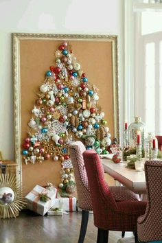 Vintage ornaments pinned on corkboard to form Christmas Tree