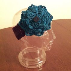 Single button headband with attached flower