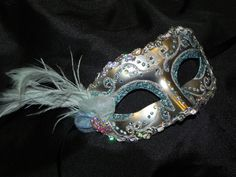 New to TheCraftyChemist07 on Etsy: Feather Masquerade Mask in Ice Blue and Silver - Made to Order (35.00 USD)