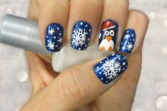 nail-art-creative-christmas-themed-snow-and-pinguin-print-nail-art-design-with-cool-blue-glitter-cool-easy-nail-design-ideas-600x400.jpg (600×400)